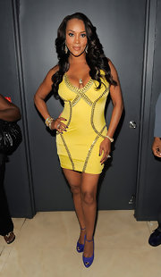 Vivica A. Fox celebrated BJ Coleman's birthday in a sexy cocktail dress. The yellow frock with studded detailing hugged her curves beautifully.
