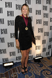 Colbie Caillat donned black perforated peep-toe sandals to the BMI Pop Awards.