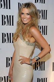 Delta Goodrem accessorized with an adorable floral cuff and a stunning diamond bracelet at the BMI Pop Music Awards.