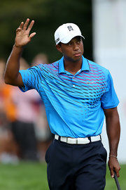 Tiger Woods chose to add a dash of color to his on-the-course look with this blue, striped polo.