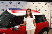 Janet Evans channeled her inner preppy in a pristine white polo shirt at the press Conference for BMW.