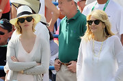 January attended a tennis match in a white wide-brimmed panama hat and casual ensemble.