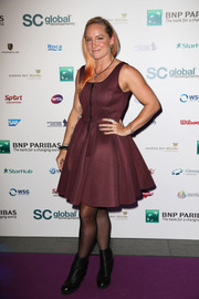 Bethanie Mattek-Sands cut a flirty silhouette in this burgundy fit-and-flare dress at the BNP Paribas WTA Finals.