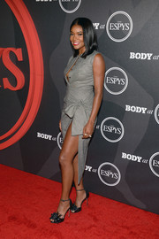 Gabrielle Union matched her top with a high-slit, knot-detail pencil skirt.