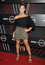 A wraparound mini skirt with military pockets completed Aly Raisman's hip outfit.