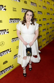 Beanie Feldstein rounded out her ensemble with a boxy floral-sequined purse.
