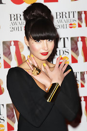 Yasmin Shahmir added a golden twist to her black gown with a dark and ominous bird skull ring with a goldtone finish.