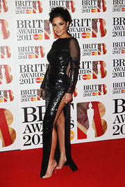 Cheryl showed some leg in a dramatic beaded evening gown at the Brit Awards.