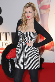 Laura Whitmore wore a black shrug sweater with her striped mini dress for added style at the 2011 Brit Awards.