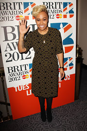 Emeli Sande gave a wave to photographers at the BRIT Awards Nominations Announcement looking ladylike in her retro-inspired geometric print dress.