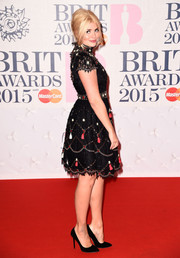 Holly Willoughby attended the BRIT Awards in cute embellished lace dress.
