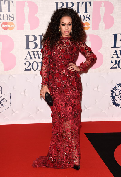 Rebecca Ferguson looked fabulous in a floor-length gown covered in floral embellishments by Yuvna Kim at the BRIT Awards.