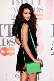Michelle Keegan attended the Brit Awards carrying a quirky green box bag.