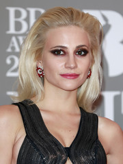 Pixie Lott dressed up her lobes with a pair of ruby and diamond hoops.