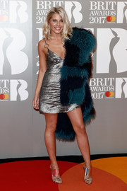 Mollie King looked foxy at the Brit Awards in a low-cut silver mini dress by Natalie & Alanna.