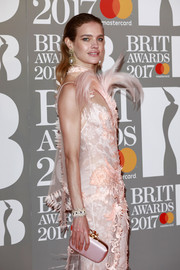 Natalia Vodianova accessorized with a pale-pink satin clutch to match her gown at the Brit Awards.