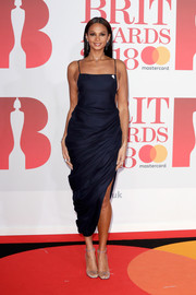 Alesha Dixon styled her frock with a pair of studded PVC sandals.