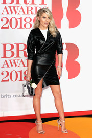 Mollie King opted for a biker-chic black leather dress with diagonal zip embellishments when she attended the 2018 Brit Awards.