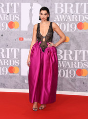 Dua Lipa completed her look with bronze slim-strap sandals.