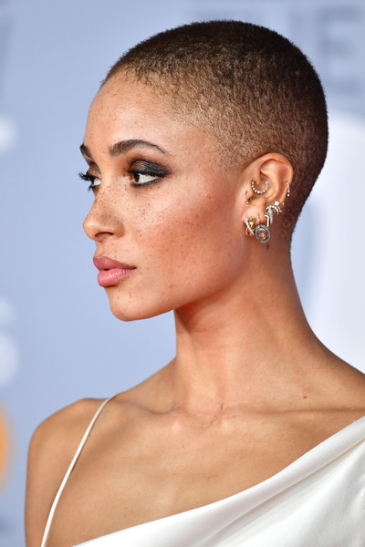 More Pics of Adwoa Aboah Feathered Clutch (1 of 19) - Adwoa Aboah Lookbook - StyleBistro [hair,face,hairstyle,ear,skin,chin,eyebrow,beauty,lip,forehead,red carpet arrivals,brit awards,london,england,the o2 arena,adwoa aboahattends the brit awards,hair coloring,hair,close-up,color,beauty.m]