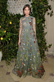 Alexa Chung looked absolutely enchanting at the Bvlgari & Rome: Eternal Inspiration opening in a Valentino empire gown featuring whimsical floral embroidery.