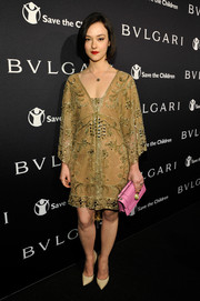 Marta Gastini chose a lovely gold-toned beaded dress for the BVLGARI And Save The Children Pre-Oscar Event.