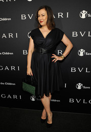 Jennifer Tilly looked fab in a simple belted dress at the BVLGARI And Save The Children Pre-Oscar Event.