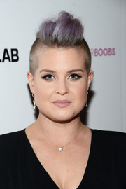 Kelly Osbourne went majorly punk with this purple mohawk for the Babes for Boobs Bachelor Auction.