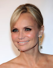 Kristin pulled her hair back to show of a dazzling pair of dangling starburst earrings. This look was so stunning on the lovely actress and they complemented the open neckline of her cocktail dress.
