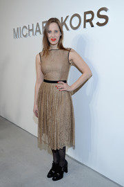 Liz Goldwyn exuded femininity in a sleeveless gold lace dress during the Michael Kors fashion show.