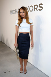 Naya Rivera showed off her wasp waist in a white Michael Kors crop-top during the brand's fashion show.