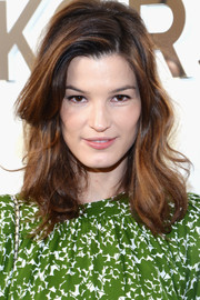 Hanneli Mustaparta sported sexy, tousled waves with side-swept bangs during the Michael Kors fashion show.