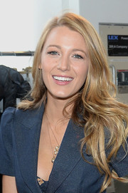 Blake Lively wore her hair loose with feathered waves when she attended the Michael Kors fashion show.