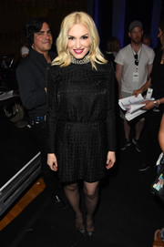 Gwen Stefani was conservative yet elegant in a long-sleeve, patterned LBD during the iHeartRadio Music Awards.