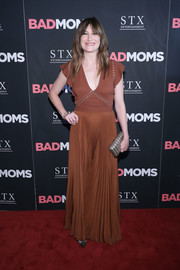 Kathryn Hahn donned a brown A.L.C. maxi dress, featuring a plunging neckline, a grommeted bodice, and a pleated skirt, for the New York premiere of 'Bad Moms.'