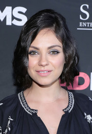 Mila Kunis finished off her beauty look with a soft pink lip.
