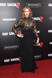 Christina Hendricks completed her well-coordinated look with a black and gold box clutch.