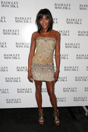 Naomi Campbell flaunted her incredibly toned body in a super-short sequined strapless dress during the Badgley Mischka fashion show.
