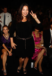 Fran Drescher livened up a basic black dress with a wrap round metal belt, accentuating the actress's still svelte waist.