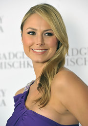 Stacey Keibler styled her hair in a side swept straight hairstyle at the Badgley Mischka store opening.