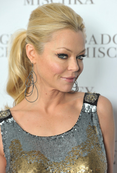 Charlotte Ross wore tiered circular earrings to the store opening of Badgley Mischka.