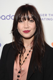 Daisy Lowe sported a long layered cut with eye-grazing bangs at the #DateOfTheDead Halloween bash.