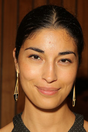 Caroline Issa glammed it up with a pair of statement earrings at the Baja East Spring 2015 show.
