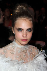 Cara Delevingne tied her gold locks up in a bun at the Bal De La Rose Du Rocher gala.