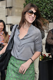 Looking the epitome of Parisian chic in her oversized round sunglasses, Charlotte Gainsbourg smiled for photographers as she arrived at the 2011 Balenciaga fashion show.