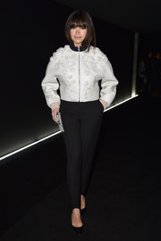 Miroslava Duma bundled up in trendy style with a boxy white Balenciaga cropped jacket for the label's fashion show.