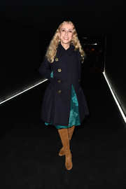 Franca Sozzani layered a black fit-and-flare coat over a teal cocktail dress for the Balenciaga fashion show.