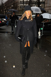 Anna dello Russo looked unusually subdued in a black Balenciaga wool coat during the brand's fashion show.