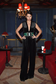 Adriana Lima was '70s-glam in a flared black Balmain jumpsuit during the label's aftershow dinner.