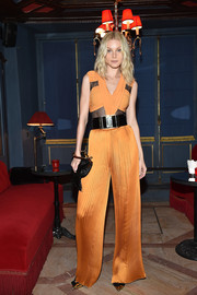 Jessica Stam donned a hot-off-the-runway sheer-panel jumpsuit by Balmain for the label's aftershow dinner.